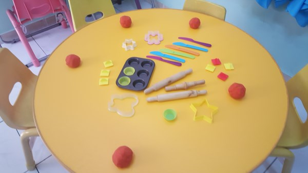 Play dough developing small hand muscles.