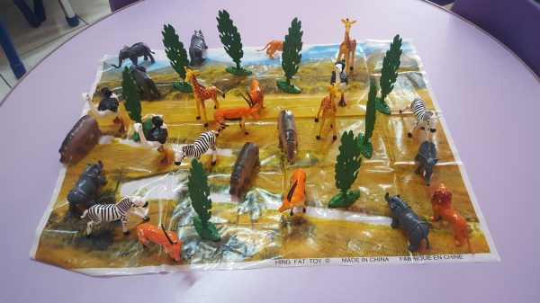 Small world play with jungle animals.