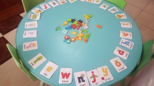 Literacy - Matching wooden letters to letter cards.