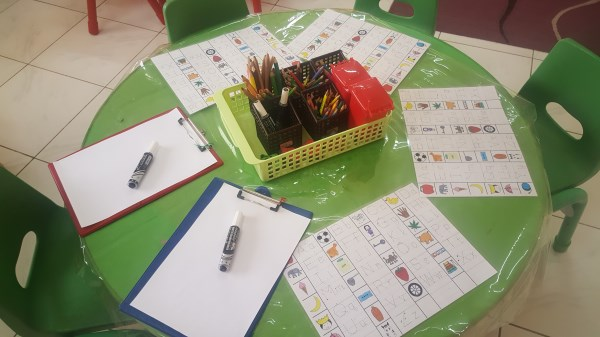 Literacy table - recognising letters and making marks.